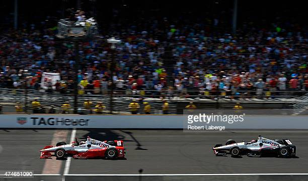 Juan Pablo Montoya of Colombia driver of the Team Penske Chevrolet Dallara crosses the finish line to win the 99th running of the Indianapolis 500...