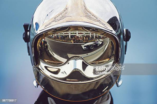 Juan Pablo Montoya of Colombia driving the BMW WilliamsF1 Team WilliamsBMW FW25 is reflected in the visor of a firemanduring practice for the...