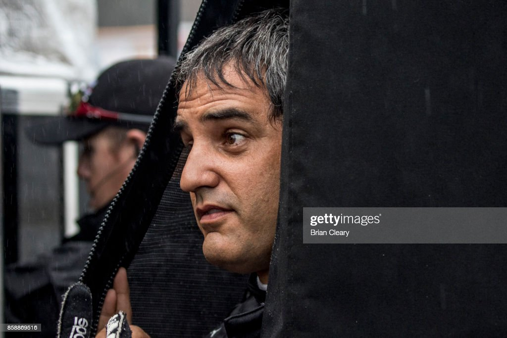 Juan Pablo Montoya, of Colombia, looks out from under cover as rain falls during practice before the Motul Petit Le Mans at Road Atlanta on October 7, 2017 in Braselton, Georgia.