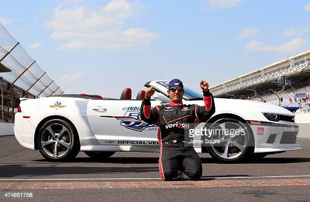 Juan Pablo Montoya of Columbia driver of the Team Penske Chevrolet Dallara celebrates after kissing the bricks following his victory in the 99th...