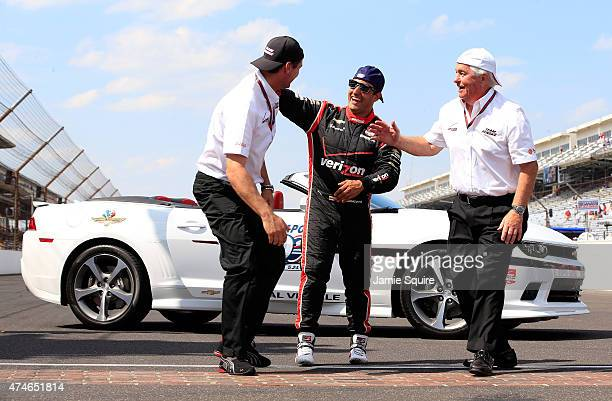 Juan Pablo Montoya of Columbia driver of the Team Penske Chevrolet Dallara celebrates with Team Penske President Tim Cindric and owner Roger Penske...