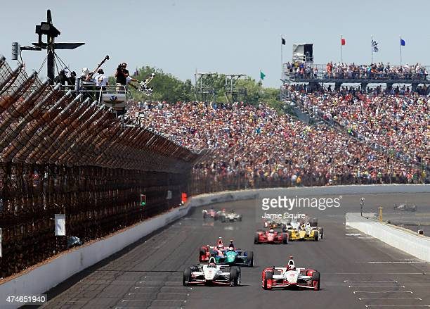 Juan Pablo Montoya of Columbia driver of the Team Penske Chevrolet Dallara celebrates after crossing the finish line to win the 99th running of the...