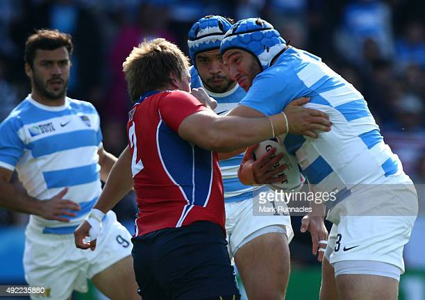 Juan Pablo Orlandi of Argentina is tackled by Torsten Van Jaarsveld of Namibia during the 2015 Rugby World Cup Pool C match between Argentina and...