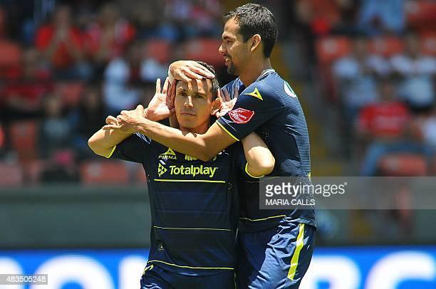 Juan Pablo Rodriguez of Morelia celebrates his goal against Toluca with his teammate Pablo Velazquez during their Mexican Apertura 2015 tournament...