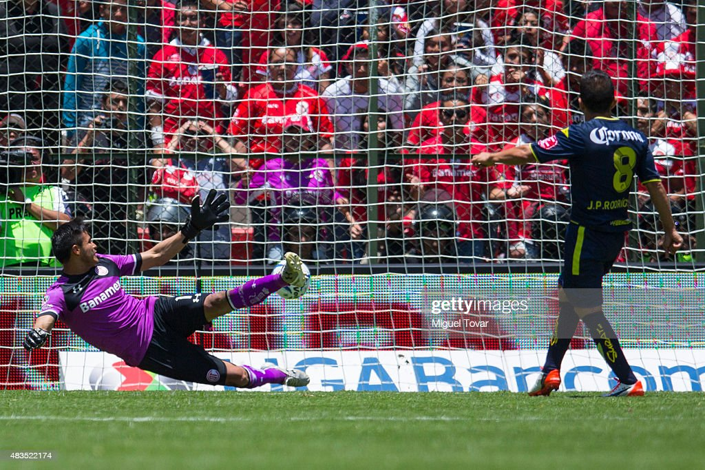 Juan Pablo Rodriguez of Morelia scores the first goal of his team from the penalty spot past <a gi-track='captionPersonalityLinkClicked' href=/galleries/search?phrase=Alfredo+Talavera&family=editorial&specificpeople=697019 ng-click='$event.stopPropagation()'>Alfredo Talavera</a> goalkeeper of Toluca during a 3rd round match between Toluca and Morelia as part of the Apertura 2015 Liga MX at Nemesio Diez Stadium on August 09, 2015 in Toluca, Mexico.
