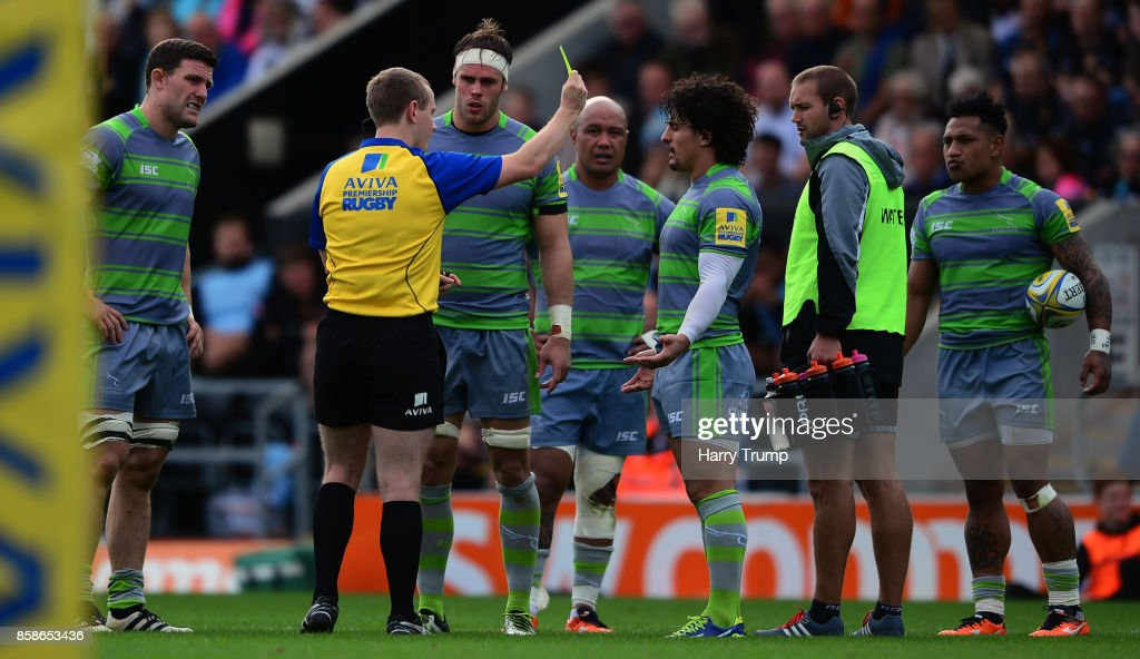Juan Pablo Socino of Newcastle Falcons(3R) is shown a yellow card during the Aviva Premiership match between Exeter Chiefs and Newcastle Falcons at Sandy Park on October 7, 2017 in Exeter, England.
