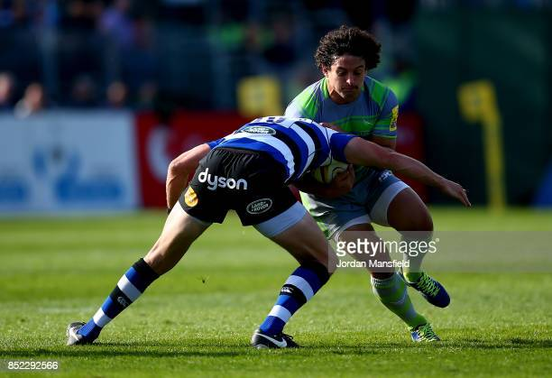 Juan Pablo Socino of Newcastle is tackled by Rhys Priestland of Bath during the Aviva Premiership match between Bath Rugby and Newcastle Falcons at...