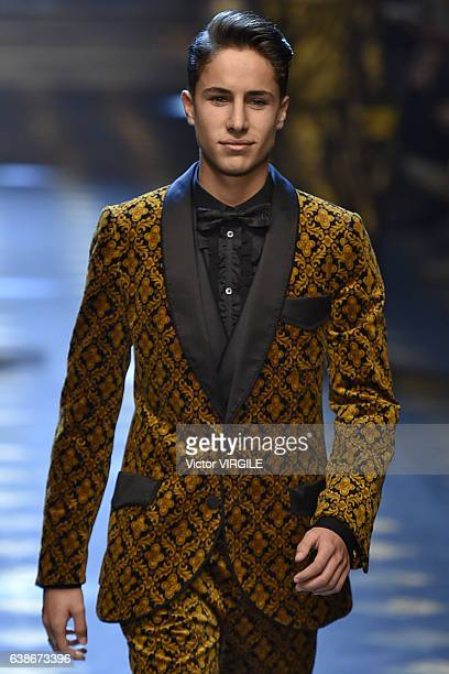 Juan Pablo Zurita walks the runway at the Dolce Gabbana show during Milan Men's Fashion Week Fall/Winter 2017/18 on January 14 2017 in Milan Italy