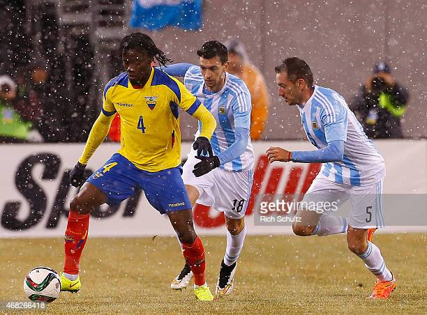 Juan Paredes of Ecuador as Javier Pastore and Federico Mancuello of Argentina defends in the first half during an international friendly match...