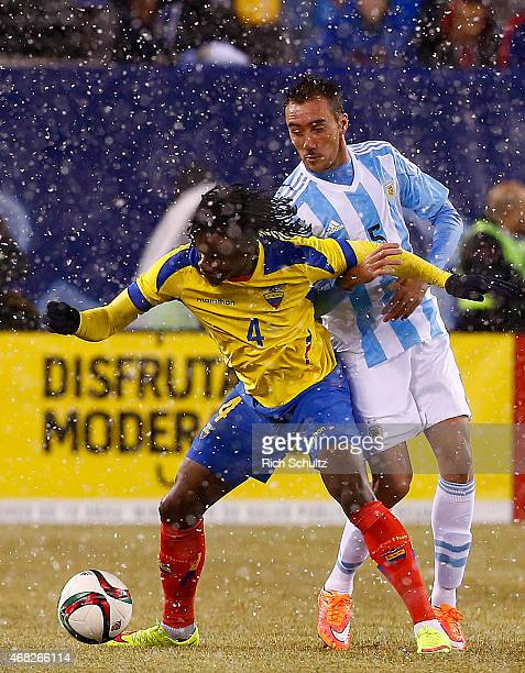 Juan Paredes of Ecuador holds back Federico Mancuello of Argentina during an international friendly match between Argentina and Ecuador at Metlife...