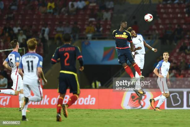 Juan Penaloza of Colombia and Chris Gloster of USA vie for a ball during the group stage football match between USA and Colombia in the FIFA U17...