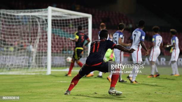 Juan Penaloza of Colombia watches as he scores from a free kick during the FIFA U17 World Cup India 2017 group B match between USA and Colombia at Dr...