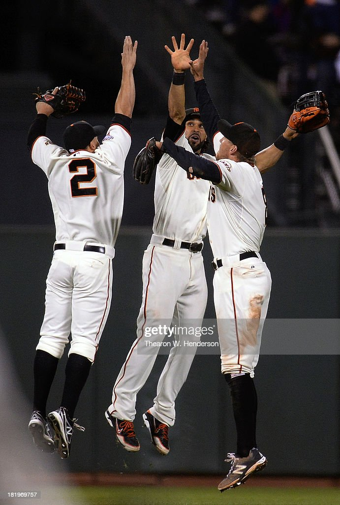 Juan Perez #2, <a gi-track='captionPersonalityLinkClicked' href=/galleries/search?phrase=Angel+Pagan&family=editorial&specificpeople=666596 ng-click='$event.stopPropagation()'>Angel Pagan</a> #16 and <a gi-track='captionPersonalityLinkClicked' href=/galleries/search?phrase=Hunter+Pence&family=editorial&specificpeople=757341 ng-click='$event.stopPropagation()'>Hunter Pence</a> #8 of the San Francisco Giants celebrate defeating the Los Angeles Dodgers 3-2 at AT&T Park on September 26, 2013 in San Francisco, California.