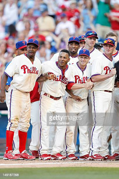 Juan Pierre Michael Martinez Hector Luna Mike Fontenot and Brian Schneider anxiously await Jim Thome's arrival at home plate after he hit a walk off...