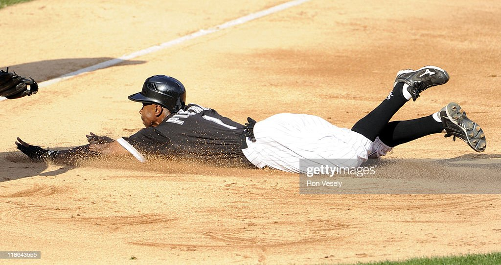 <a gi-track='captionPersonalityLinkClicked' href=/galleries/search?phrase=Juan+Pierre&family=editorial&specificpeople=202961 ng-click='$event.stopPropagation()'>Juan Pierre</a> #1 of the Chicago White Sox advances safely into third base on a fly ball hit by Adam Dunn #32 against the Minnesota Twins on July 9, 2011 at U.S. Cellular Field in Chicago, Illinois. The White Sox defeated the Twins 4-3.