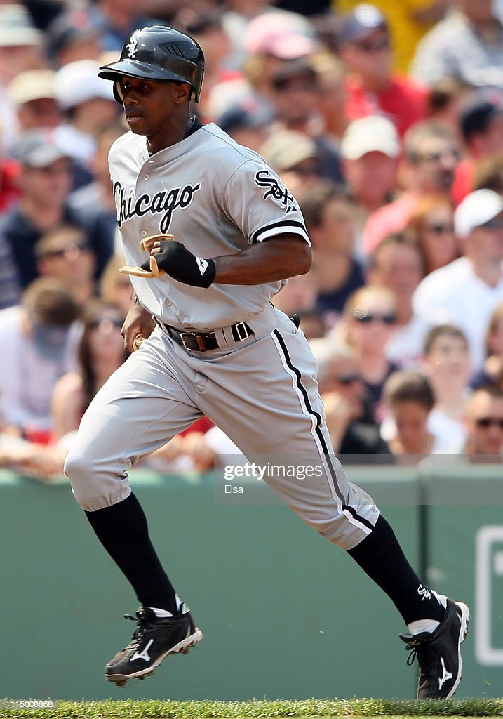 <a gi-track='captionPersonalityLinkClicked' href=/galleries/search?phrase=Juan+Pierre&family=editorial&specificpeople=202961 ng-click='$event.stopPropagation()'>Juan Pierre</a> #1 of the Chicago White Sox scores a run against the Boston Red Sox on June 1, 2011 at Fenway Park in Boston, Massachusetts.
