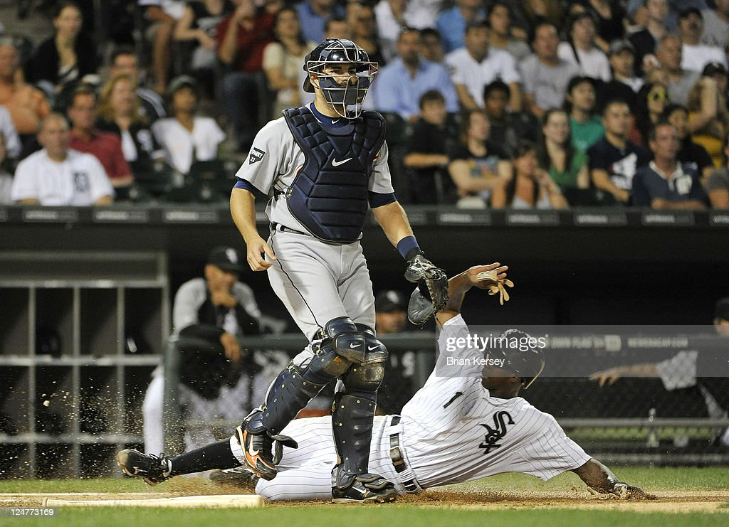 <a gi-track='captionPersonalityLinkClicked' href=/galleries/search?phrase=Juan+Pierre&family=editorial&specificpeople=202961 ng-click='$event.stopPropagation()'>Juan Pierre</a> #1 of the Chicago White Sox scores past catcher <a gi-track='captionPersonalityLinkClicked' href=/galleries/search?phrase=Alex+Avila&family=editorial&specificpeople=5749211 ng-click='$event.stopPropagation()'>Alex Avila</a> #13 of the Detroit Tigers after Dayan Viciedo #24 hit a ground ball to third base during the first inning at U.S. Cellular Field on September 12, 2011 in Chicago, Illinois.