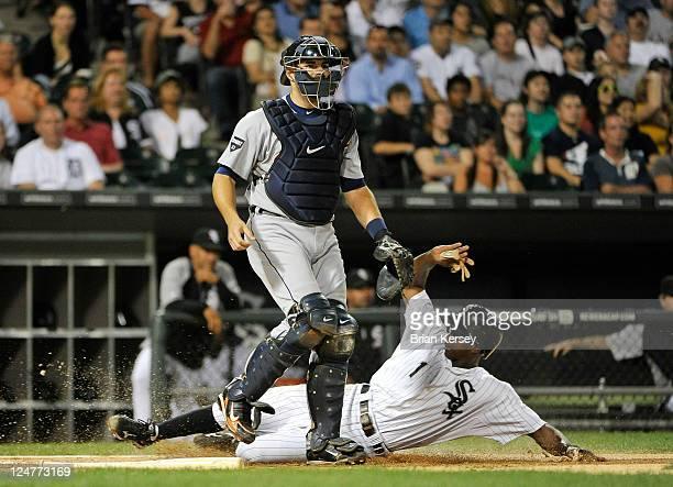 Juan Pierre of the Chicago White Sox scores past catcher Alex Avila of the Detroit Tigers after Dayan Viciedo hit a ground ball to third base during...