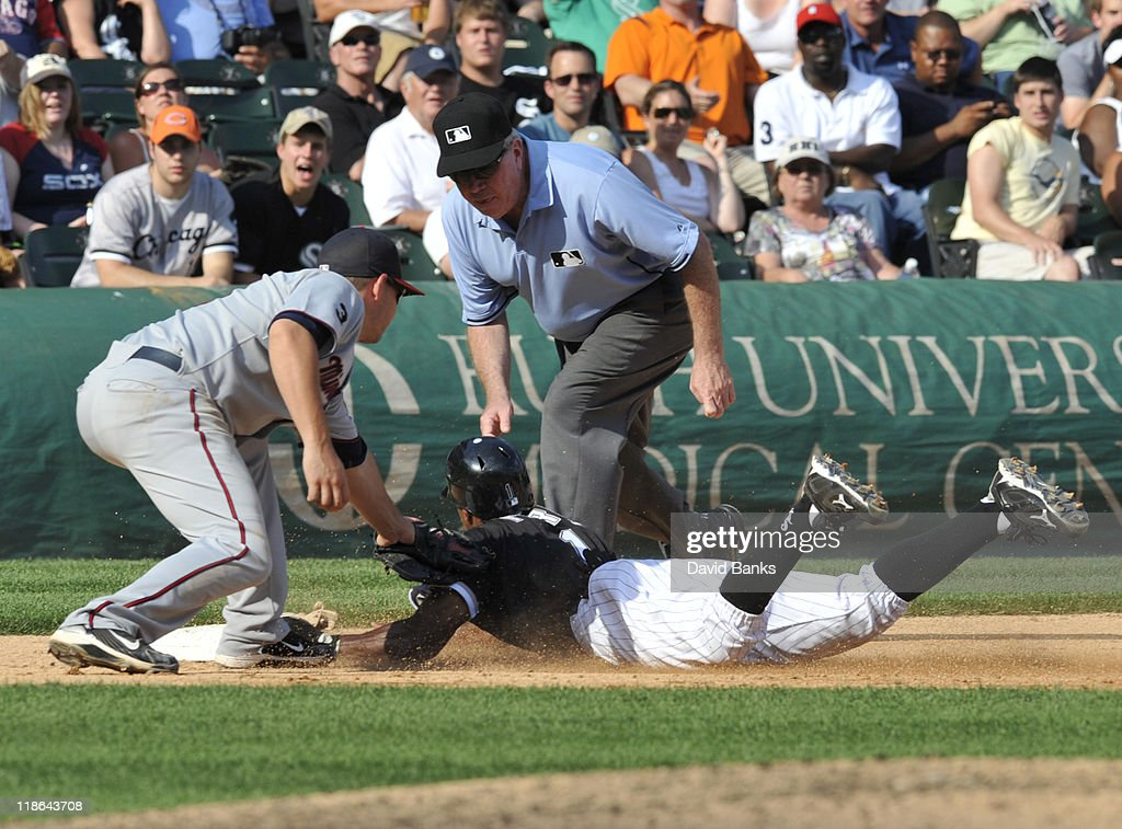 Juan Pierre #1 of the Chicago White Sox slides safely into third base as Danny Valencia #19 of the Minnesota Twins place the tag on July 9, 2011 at U.S. Cellular Field in Chicago, Illinois. The White Sox defeated the Twins 4-3.
