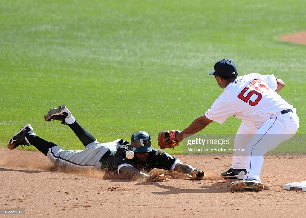 Juan Pierre #1 of the Chicago White Sox steals second base while Yamaico Navarro #56 of the Boston Red Sox misplays the throw in the seventh inning on September 5, 2010 at Fenway Park in Boston, Massachusetts.