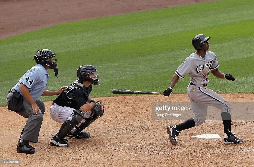 <a gi-track='captionPersonalityLinkClicked' href=/galleries/search?phrase=Juan+Pierre&family=editorial&specificpeople=202961 ng-click='$event.stopPropagation()'>Juan Pierre</a> #1 of the Chicago White Sox watches his game winning two RBI single hit the right field wall along with catcher Matt Pagnozzi #15 of the Colorado Rockies and umnpire <a gi-track='captionPersonalityLinkClicked' href=/galleries/search?phrase=Kerwin+Danley&family=editorial&specificpeople=211350 ng-click='$event.stopPropagation()'>Kerwin Danley</a> off of pitcher Clayton Mortensen #59 of the Colorado Rockies in the 10th inning during Interleague play at Coors Field on June 30, 2011 in Denver, Colorado. The White Sox defeated the Rockies 6-4 in 10 innings.