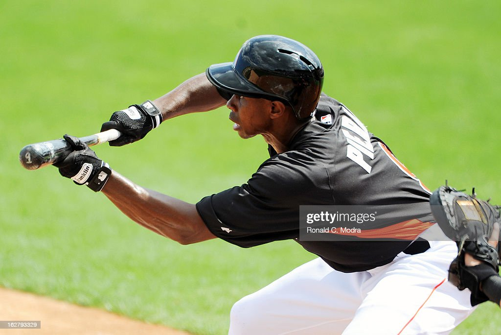Juan Pierre #9 of the Florida Marlins bats during a spring training game against the St. Louis Cardinals at Roger Dean Stadium on February 23, 2013 in Jupiter, Florida.