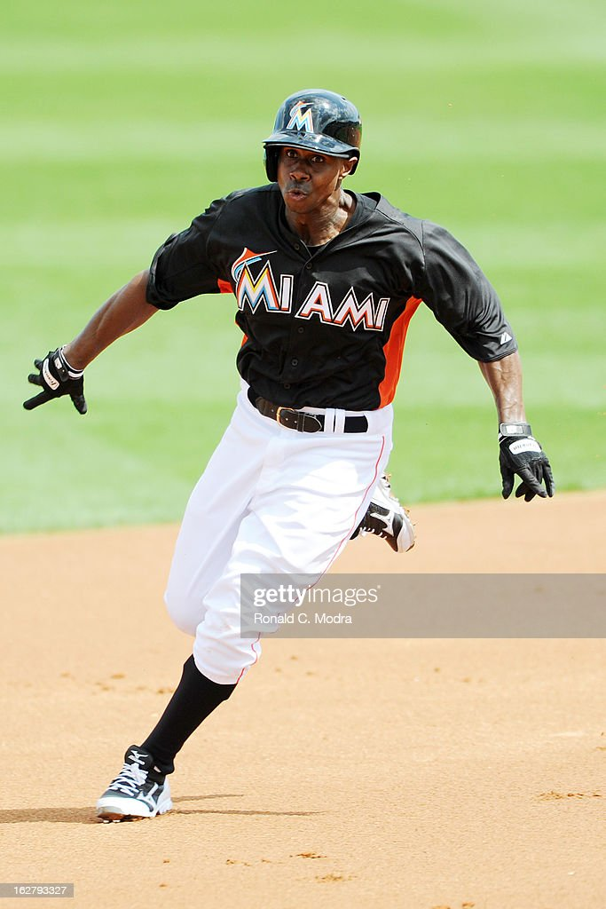 Juan Pierre #9 of the Florida Marlins runs to second base during a spring training game against the St. Louis Cardinals at Roger Dean Stadium on February 23, 2013 in Jupiter, Florida.