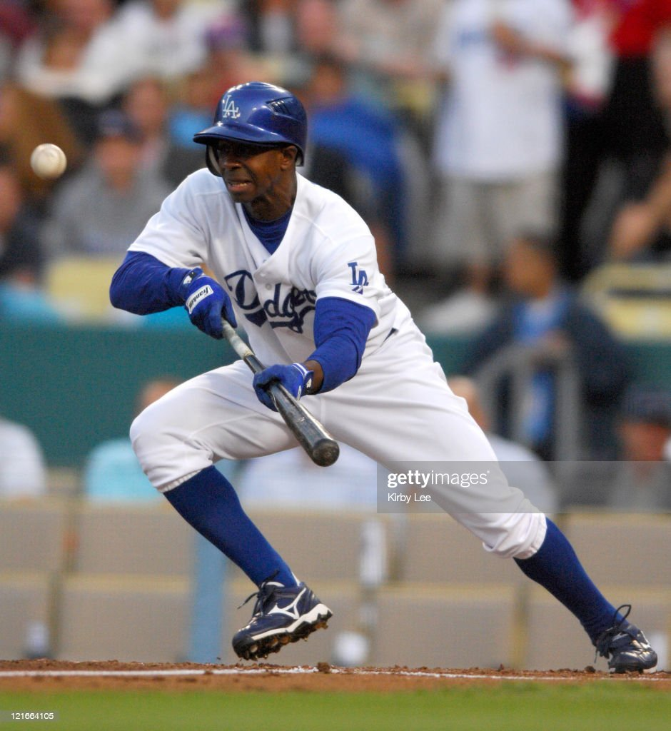 <a gi-track='captionPersonalityLinkClicked' href=/galleries/search?phrase=Juan+Pierre&family=editorial&specificpeople=202961 ng-click='$event.stopPropagation()'>Juan Pierre</a> of the Los Angeles Dodgers bunts during 8-4 loss to the St. Louis Cardinals at Dodger Stadium in Major League Baseball game at Dodger Stadium in Los Angeles, Calif. on Monday, May 14, 2007.