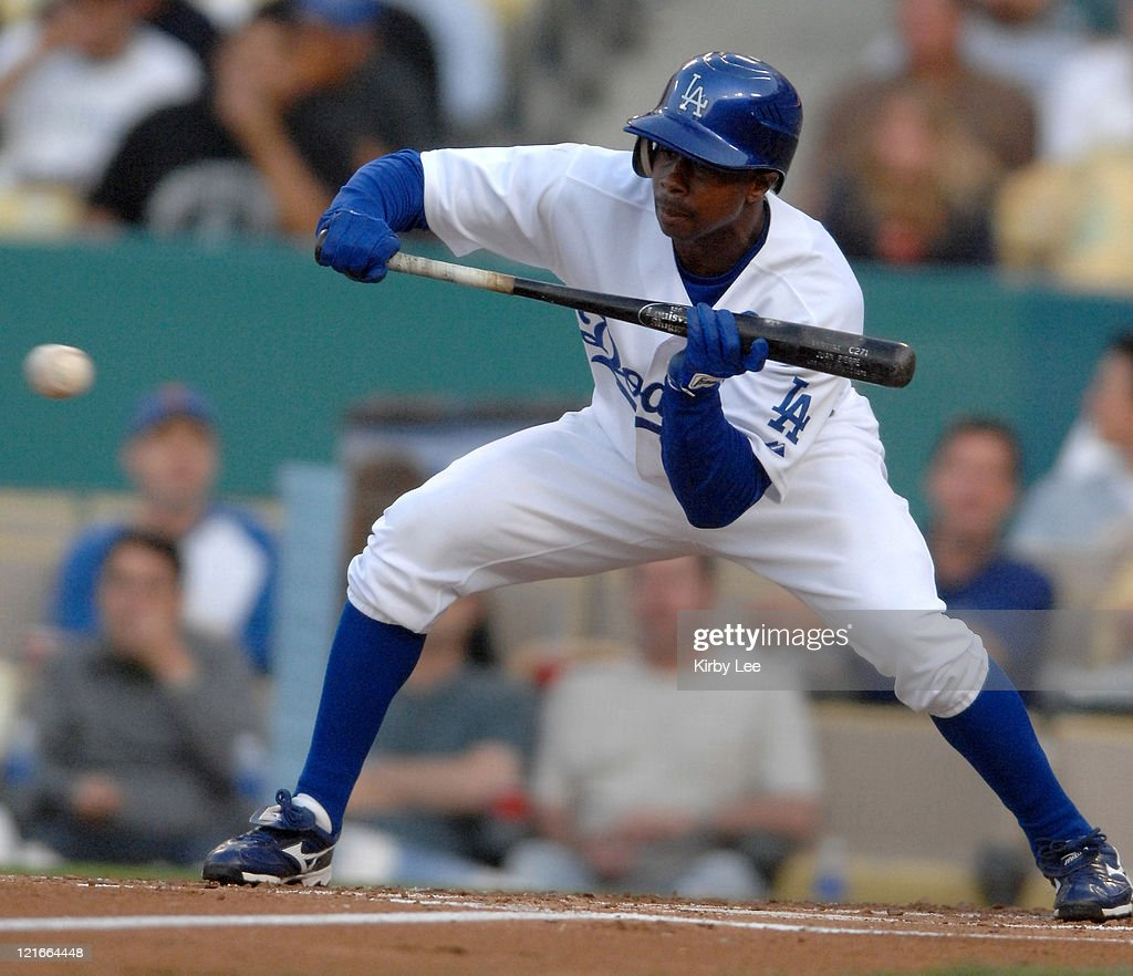 <a gi-track='captionPersonalityLinkClicked' href=/galleries/search?phrase=Juan+Pierre&family=editorial&specificpeople=202961 ng-click='$event.stopPropagation()'>Juan Pierre</a> of the Los Angeles Dodgers bunts during 9-1 victory over the New York Mets in Major League Baseball game at Dodger Stadium in Los Angeles, Calif. on Wednesday, June 13, 2007.