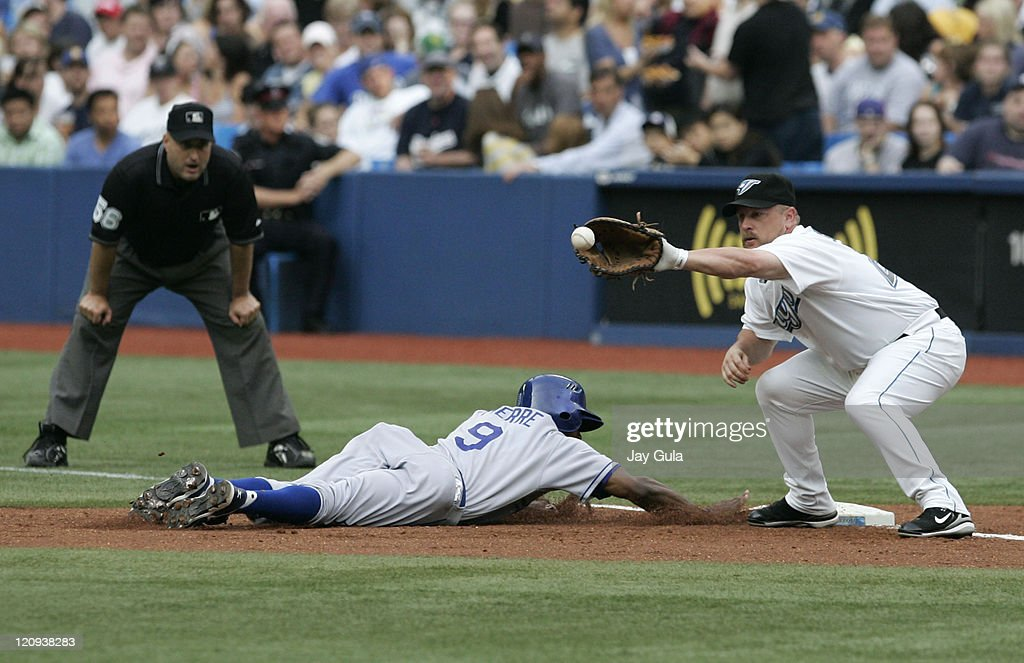 <a gi-track='captionPersonalityLinkClicked' href=/galleries/search?phrase=Juan+Pierre&family=editorial&specificpeople=202961 ng-click='$event.stopPropagation()'>Juan Pierre</a> of the Los Angeles Dodgers dives safely back to the 1st base bag ahead of the tag from Toronto's <a gi-track='captionPersonalityLinkClicked' href=/galleries/search?phrase=Matt+Stairs&family=editorial&specificpeople=209328 ng-click='$event.stopPropagation()'>Matt Stairs</a> in action at the Rogers Centre in Toronto, Canada on June 19, 2007.