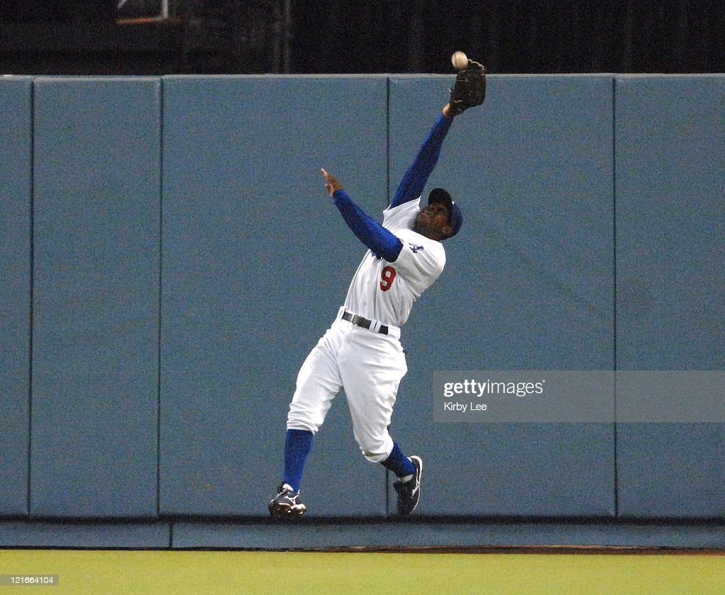 <a gi-track='captionPersonalityLinkClicked' href=/galleries/search?phrase=Juan+Pierre&family=editorial&specificpeople=202961 ng-click='$event.stopPropagation()'>Juan Pierre</a> of the Los Angeles Dodgers makes a leaping catch at the outfield wall during 2-0 victory over the Cincinnati Reds at Dodger Stadium in Los Angeles, Calif. on Friday, May 11, 2007.