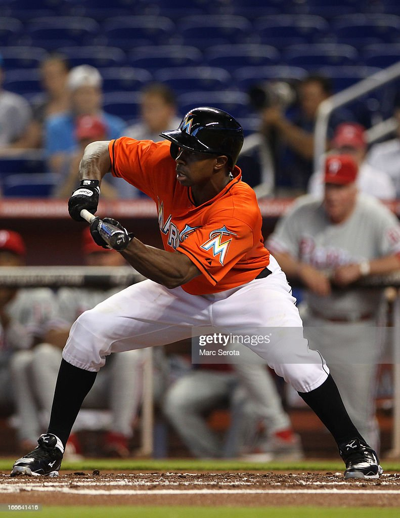 Juan Pierre of the Miami Marlins bunts against the Philadelphia Phillies at Marlins Park on April 14, 2013 in Miami, Florida. The Phillies defeated the Marlins 2-1.