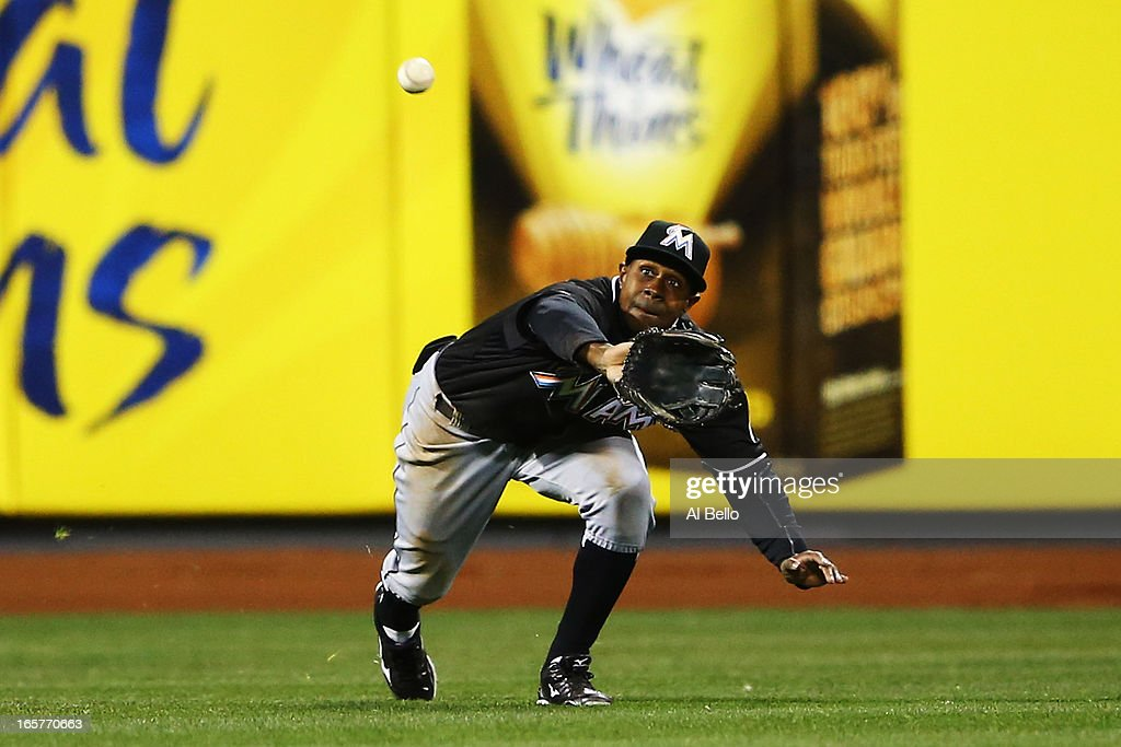 <a gi-track='captionPersonalityLinkClicked' href=/galleries/search?phrase=Juan+Pierre&family=editorial&specificpeople=202961 ng-click='$event.stopPropagation()'>Juan Pierre</a> #9 of the Miami Marlins catches a ball hit by Ike Davis #29 of the New York Mets in the fifth inning during their game on April 5, 2013 at Citi Field in the Flushing neighborhood of the Queens borough of New York City.