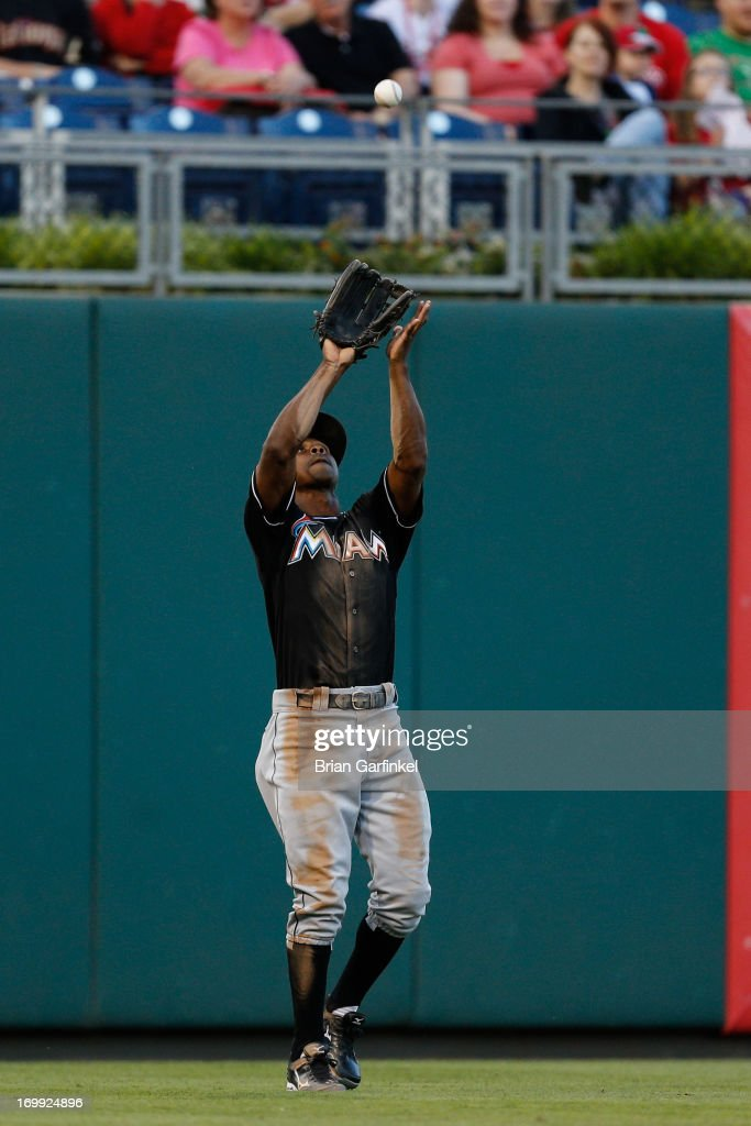 <a gi-track='captionPersonalityLinkClicked' href=/galleries/search?phrase=Juan+Pierre&family=editorial&specificpeople=202961 ng-click='$event.stopPropagation()'>Juan Pierre</a> #9 of the Miami Marlins catches a long fly in the first inning of the game against the Philadelphia Phillies at Citizens Bank Park on June 4, 2013 in Philadelphia, Pennsylvania.