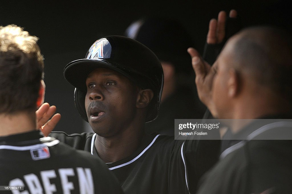 <a gi-track='captionPersonalityLinkClicked' href=/galleries/search?phrase=Juan+Pierre&family=editorial&specificpeople=202961 ng-click='$event.stopPropagation()'>Juan Pierre</a> #9 of the Miami Marlins celebrates scoring a run against the Minnesota Twins during the eighth inning of the first game of a doubleheader on April 23, 2013 at Target Field in Minneapolis, Minnesota. The Twins defeated the Marlins 4-3.