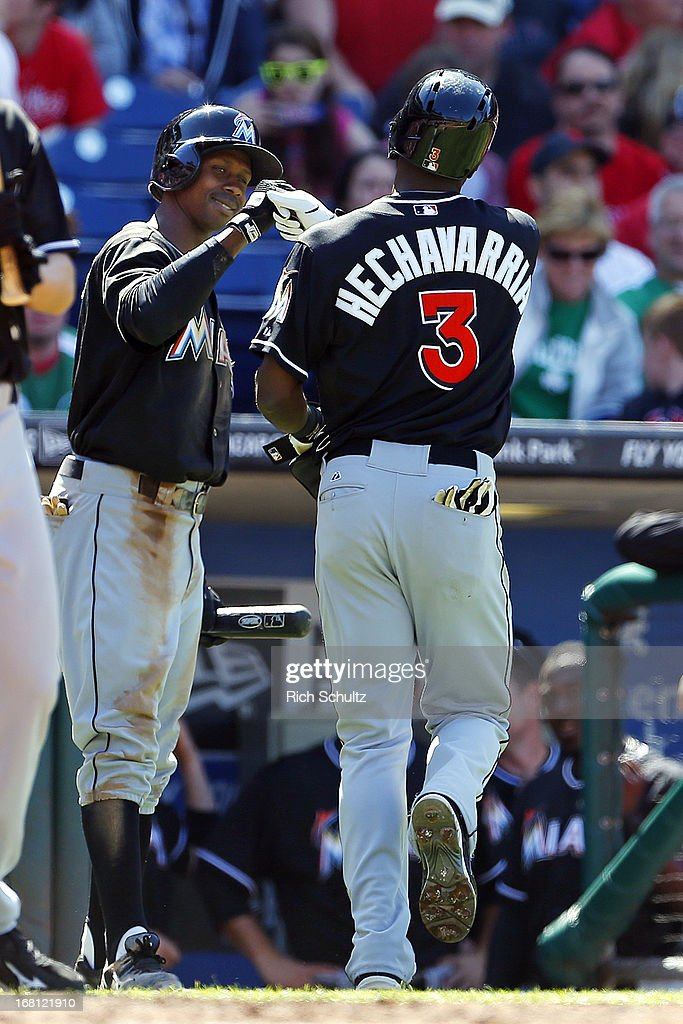 <a gi-track='captionPersonalityLinkClicked' href=/galleries/search?phrase=Juan+Pierre&family=editorial&specificpeople=202961 ng-click='$event.stopPropagation()'>Juan Pierre</a> #9 of the Miami Marlins congratulates teammate <a gi-track='captionPersonalityLinkClicked' href=/galleries/search?phrase=Adeiny+Hechavarria&family=editorial&specificpeople=6926508 ng-click='$event.stopPropagation()'>Adeiny Hechavarria</a>, who hit a grand slam home run, in the third inning against the Philadelphia Phillies in a MLB baseball game on May 5, 2013 at Citizens Bank Park in Philadelphia, Pennsylvania. The Marlins defeated the Phillies 14-2.