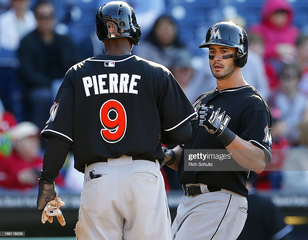 <a gi-track='captionPersonalityLinkClicked' href=/galleries/search?phrase=Juan+Pierre&family=editorial&specificpeople=202961 ng-click='$event.stopPropagation()'>Juan Pierre</a> #9 of the Miami Marlins congratulates teammate <a gi-track='captionPersonalityLinkClicked' href=/galleries/search?phrase=Justin+Ruggiano&family=editorial&specificpeople=4536828 ng-click='$event.stopPropagation()'>Justin Ruggiano</a> #20, after Ruggiano hit a two-run homer in the ninth inning against the Philadelphia Phillies in a MLB baseball game on May 5, 2013 at Citizens Bank Park in Philadelphia, Pennsylvania. The Marlins defeated the Phillies 14-2.