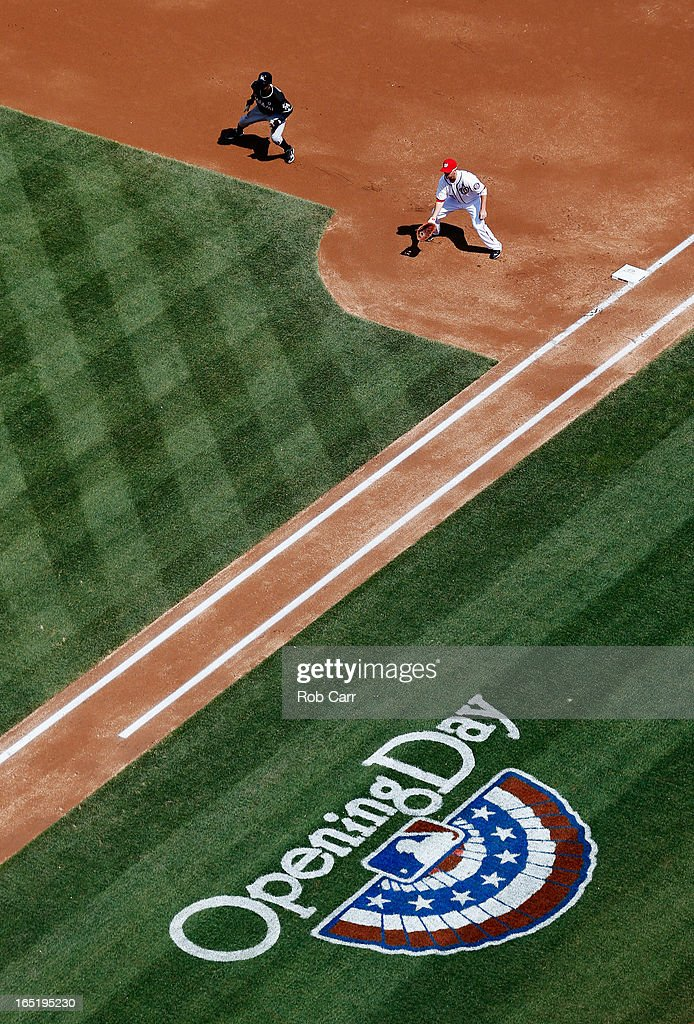 <a gi-track='captionPersonalityLinkClicked' href=/galleries/search?phrase=Juan+Pierre&family=editorial&specificpeople=202961 ng-click='$event.stopPropagation()'>Juan Pierre</a> #9 of the Miami Marlins leads off the base as <a gi-track='captionPersonalityLinkClicked' href=/galleries/search?phrase=Adam+LaRoche&family=editorial&specificpeople=216533 ng-click='$event.stopPropagation()'>Adam LaRoche</a> #25 of the Washington Nationals waits for the pitch during the first inning of their opening day game at Nationals Park on April 1, 2013 in Washington, DC.