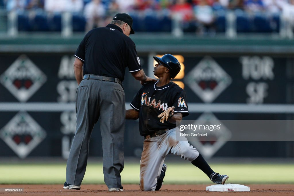 <a gi-track='captionPersonalityLinkClicked' href=/galleries/search?phrase=Juan+Pierre&family=editorial&specificpeople=202961 ng-click='$event.stopPropagation()'>Juan Pierre</a> #9 of the Miami Marlins looks up at the umpire after being called out when attempting to steal second in the first inning of the game against the Philadelphia Phillies at Citizens Bank Park on June 4, 2013 in Philadelphia, Pennsylvania.
