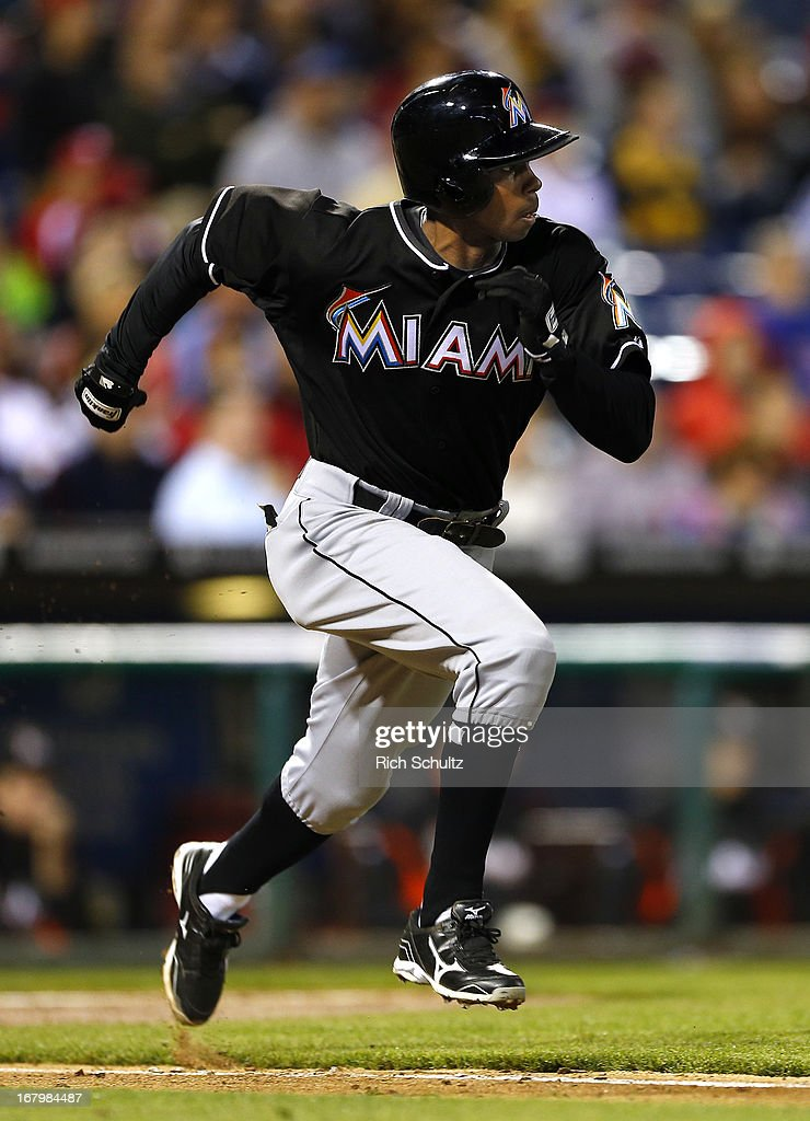 <a gi-track='captionPersonalityLinkClicked' href=/galleries/search?phrase=Juan+Pierre&family=editorial&specificpeople=202961 ng-click='$event.stopPropagation()'>Juan Pierre</a> #9 of the Miami Marlins runs to first to beat the throw for an infield hitl during the sixth inning in a MLB baseball game on May 3, 2013 at Citizens Bank Park in Philadelphia, Pennsylvania. The Phillies defeated the Marlins 4-1.