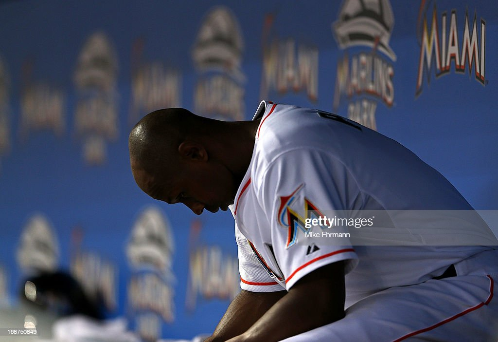 <a gi-track='captionPersonalityLinkClicked' href=/galleries/search?phrase=Juan+Pierre&family=editorial&specificpeople=202961 ng-click='$event.stopPropagation()'>Juan Pierre</a> #9 of the Miami Marlins sits in the dugout during a game against the Cincinnati Reds at Marlins Park on May 14, 2013 in Miami, Florida.