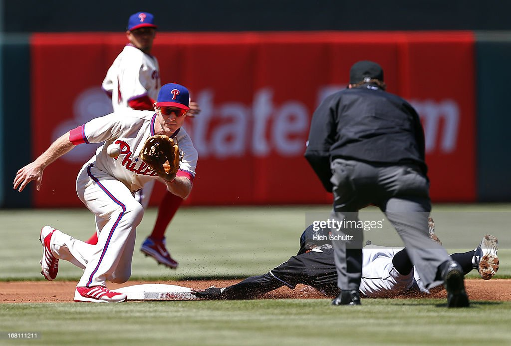 <a gi-track='captionPersonalityLinkClicked' href=/galleries/search?phrase=Juan+Pierre&family=editorial&specificpeople=202961 ng-click='$event.stopPropagation()'>Juan Pierre</a> #9 of the Miami Marlins steals second base before second baseman <a gi-track='captionPersonalityLinkClicked' href=/galleries/search?phrase=Chase+Utley&family=editorial&specificpeople=161391 ng-click='$event.stopPropagation()'>Chase Utley</a> #26 of the Philadelphia Phillies gets the ball during the first inning in a MLB baseball game on May 5, 2013 at Citizens Bank Park in Philadelphia, Pennsylvania.