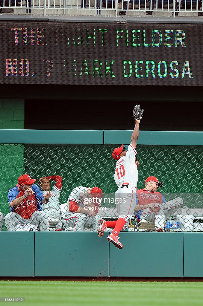 <a gi-track='captionPersonalityLinkClicked' href=/galleries/search?phrase=Juan+Pierre&family=editorial&specificpeople=202961 ng-click='$event.stopPropagation()'>Juan Pierre</a> #10 of the Philadelphia Phillies catches a fly ball in the first inning hit by Mark DeRosa #7 (not pictured) of the Washington Nationals at Nationals Park on October 3, 2012 in Washington, DC.