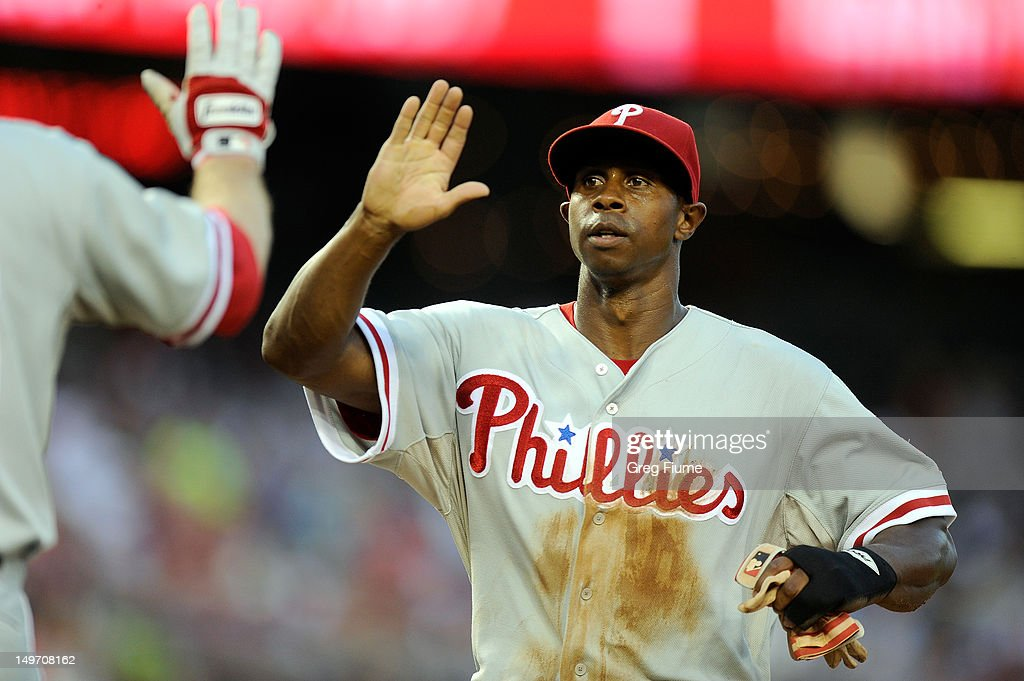 <a gi-track='captionPersonalityLinkClicked' href=/galleries/search?phrase=Juan+Pierre&family=editorial&specificpeople=202961 ng-click='$event.stopPropagation()'>Juan Pierre</a> #10 of the Philadelphia Phillies celebrates after scoring in the third inning against the Washington Nationals at Nationals Park on July 31, 2012 in Washington, DC.