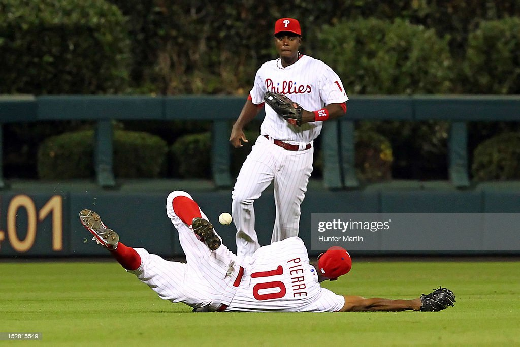 <a gi-track='captionPersonalityLinkClicked' href=/galleries/search?phrase=Juan+Pierre&family=editorial&specificpeople=202961 ng-click='$event.stopPropagation()'>Juan Pierre</a> #10 of the Philadelphia Phillies dives for a fly ball during a game against the Washington Nationals at Citizens Bank Park on September 26, 2012 in Philadelphia, Pennsylvania. The Nationals won 8-4.