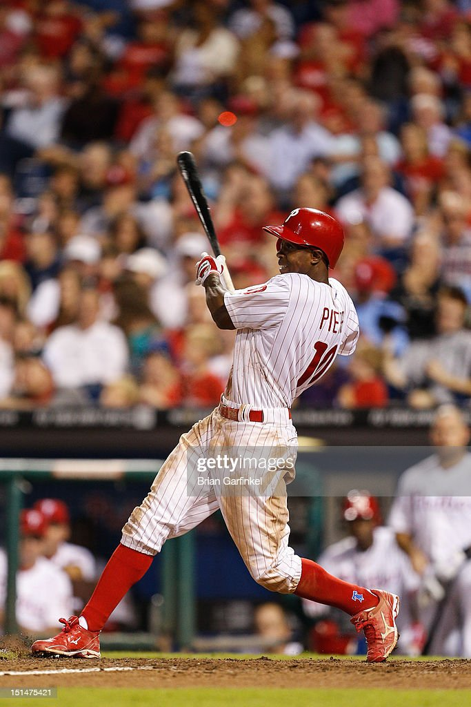 <a gi-track='captionPersonalityLinkClicked' href=/galleries/search?phrase=Juan+Pierre&family=editorial&specificpeople=202961 ng-click='$event.stopPropagation()'>Juan Pierre</a> #10 of the Philadelphia Phillies hits a single in the seventh inning of the game against the Colorado Rockies at Citizens Bank Park on September 7, 2012 in Philadelphia, Pennsylvania. The Phillies won 3-2.