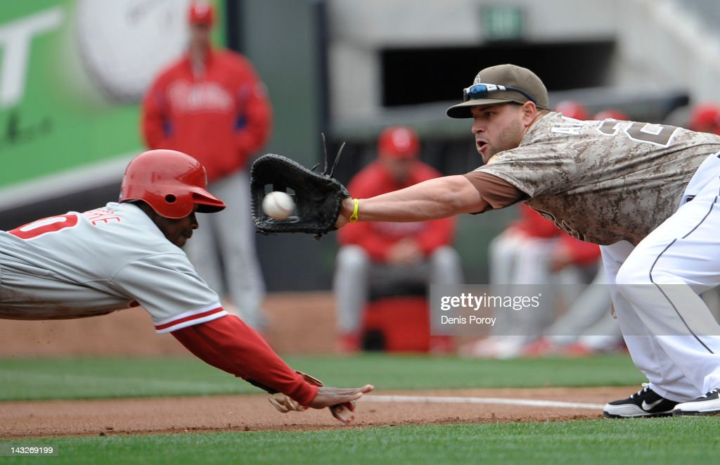Juan Pierre of the Philadelphia Phillies is caught leading off first base by Yonder Alonso of the San Diego Padres in the first inning of a baseball...