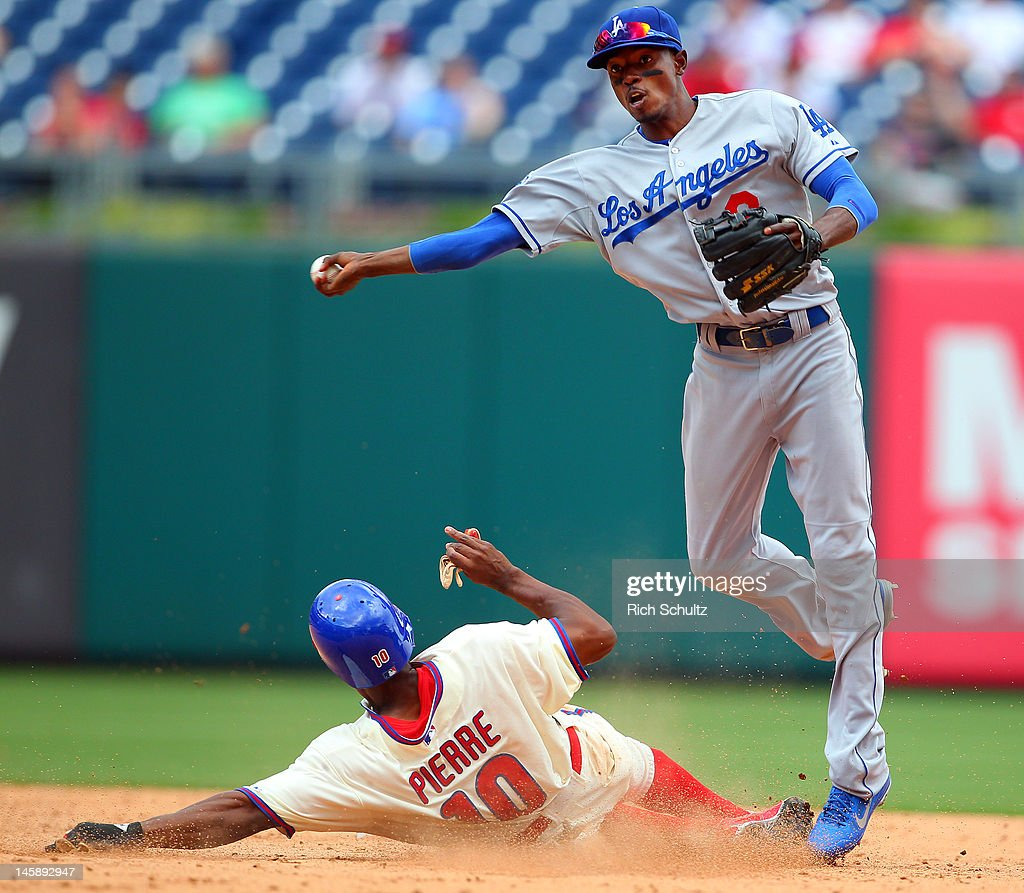 <a gi-track='captionPersonalityLinkClicked' href=/galleries/search?phrase=Juan+Pierre&family=editorial&specificpeople=202961 ng-click='$event.stopPropagation()'>Juan Pierre</a> #10 of the Philadelphia Phillies is out at second base as shortstop <a gi-track='captionPersonalityLinkClicked' href=/galleries/search?phrase=Dee+Gordon&family=editorial&specificpeople=7091343 ng-click='$event.stopPropagation()'>Dee Gordon</a> #9 of the Los Angeles Dodgers throws over to first base to get Hunter Pence #3 (not pictured) of the Phillies for the game ending double play in a MLB baseball game on June 7, 2012 at Citizens Bank Park in Philadelphia, Pennsylvania. The Dodgers defeated the Phillies 8-3.
