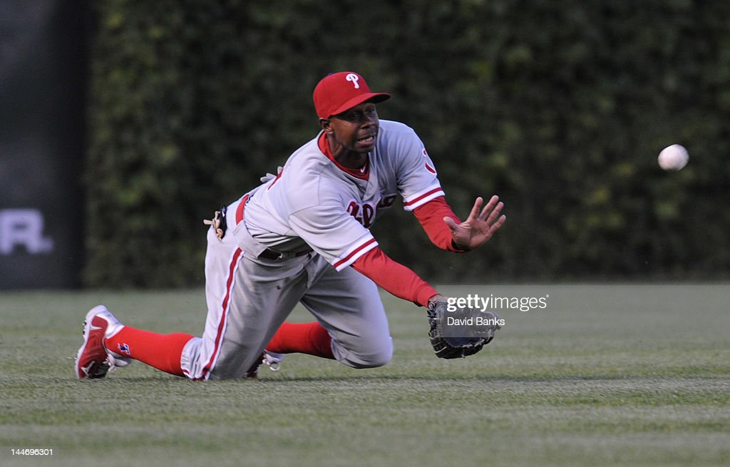 <a gi-track='captionPersonalityLinkClicked' href=/galleries/search?phrase=Juan+Pierre&family=editorial&specificpeople=202961 ng-click='$event.stopPropagation()'>Juan Pierre</a> #10 of the Philadelphia Phillies makes a diving catch in the first inning against the Chicago Cubs on May 17, 2012 at Wrigley Field in Chicago, Illinois.