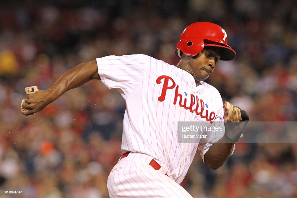 <a gi-track='captionPersonalityLinkClicked' href=/galleries/search?phrase=Juan+Pierre&family=editorial&specificpeople=202961 ng-click='$event.stopPropagation()'>Juan Pierre</a> #10 of the Philadelphia Phillies rounds third base during a game against the Miami Marlins at Citizens Bank Park on September 11, 2012 in Philadelphia, Pennsylvania.